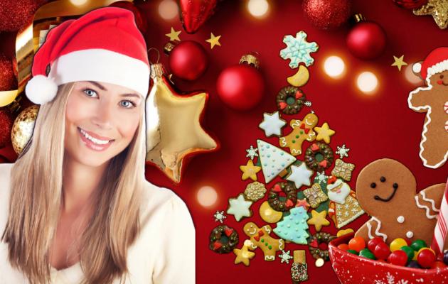 In questa immagine, vediamo una ragazza bionda che indossa un cappello da Babbo Natale, pronta per il pranzo di Natale. Sullo sfondo, decorazioni natalizie e un albero fatto di biscotti e dolci.